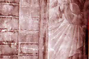 """Pavia (PV) - Chiesa di Santa Maria del Carmine, Dipinto murale, Leonardo Vidolenghi (1463) - Diocesi di Pavia - Sul sesto pilastro della chiesa si trova un tabellone votivo a fresco, opera di Leonardo Vidolenghi, dove sono raffigurati la Madonna in trono col Bambino, San Lucio, Santa Lucia e l'offerente inginocchiato in basso a destra. Il dipinto recava una scritta, ancora leggibile all'inizio del Novecento, che ci dava indicazioni circa l'autore e la data di esecuzione: """"Leonardo de Guidolengi di Marzano pinxit 1463"""". Il San Lucio qui rappresentato è lo stesso venerato in Val Cavargna, patrono dei casari e dei mandriani. Infatti è rappresentato nella veste di un pastore d'armenti, con indosso una camicia dal colletto a listello, un farsetto rosa, la calzamaglia verde ed i calzari neri. Appoggiato sulle spalle ha un mantello verde foderato in giallo. Con le mani regge un coltellaccio e la forma di cacio da cui ha tagliato una fetta. Il viso è giovanile ed imberbe ed i capelli biondi sono in parte coperti da un copricapo di pelo a forma di cono schiacciato (P. Villa)"""